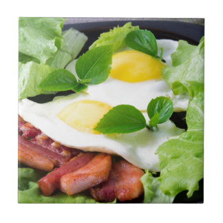 Fried eggs with herbs, lettuce and  bacon ceramic tile