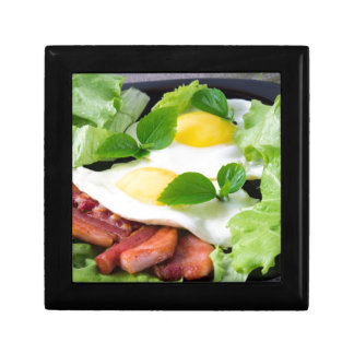 Fried eggs with herbs, lettuce and  bacon gift box