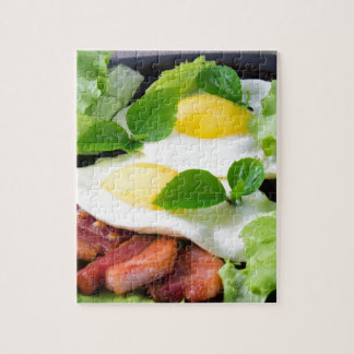 Fried eggs with herbs, lettuce and  bacon jigsaw puzzle