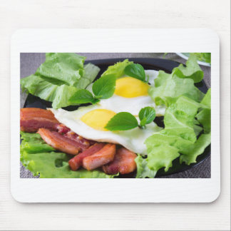 Fried eggs with herbs, lettuce and  bacon mouse pad