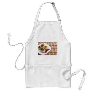 Fried meatballs of minced chicken on a stripe back standard apron