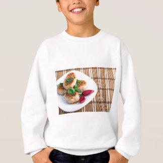Fried meatballs of minced chicken on a stripe back sweatshirt