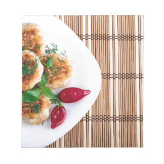 Fried meatballs of minced chicken with red pepper notepad