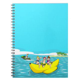 Friendly group amusing itself in a boat banana notebook