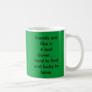 friends are like a 4 leaf clover....hard to fin... basic white mug