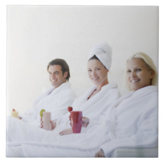 Friends drinking fruit smoothies at spa large square tile