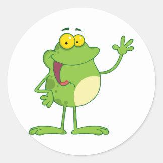 Frog Cartoon Mascot Character Waving A Greeting Round Sticker