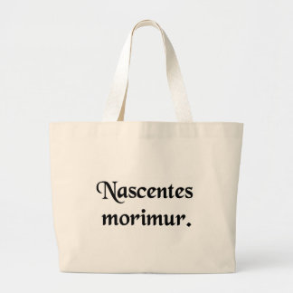 From the moment we are born, we begin to die. tote bags