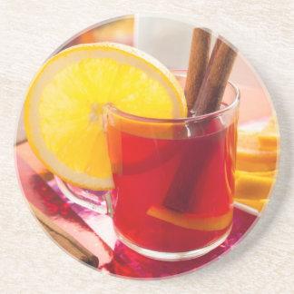 Fruit citrus tea with cinnamon and orange coaster