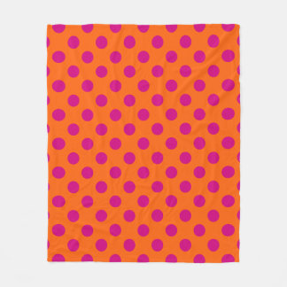 Fuchsia polka dots on orange fleece blanket
