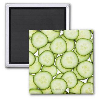 Full frame of sliced cucumber, on white magnet