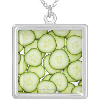 Full frame of sliced cucumber, on white jewelry