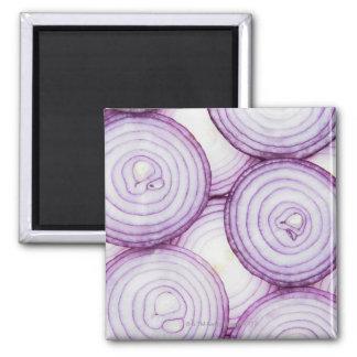 Full frame of sliced red onion, on white square magnet