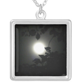 Full moon through leaves silver plated necklace