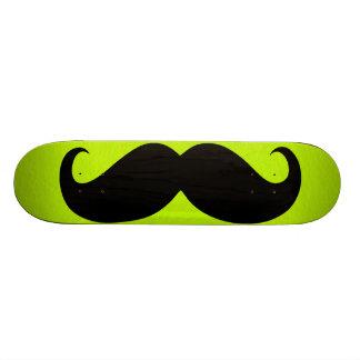 Funny black mustache on green background 21.6 cm skateboard deck