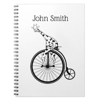 Funny giraffee riding a penny-farthing notebooks