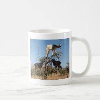 Funny goats in a tree coffee mug