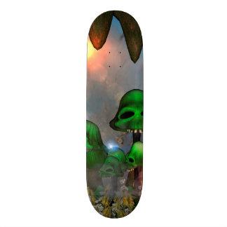 Funny green skull mushrooms mit flowers in a cave skateboard decks