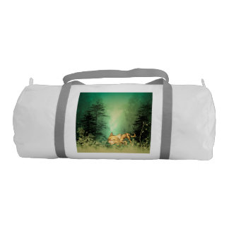 Funny kitten with baby cat in the wood gym duffel bag