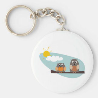 Funny owls on branch on sunny day illustration key ring