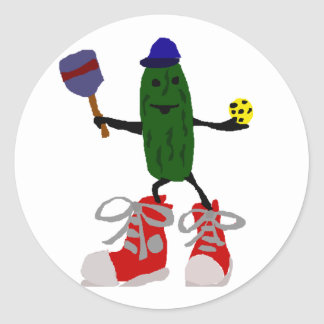 Funny Pickle Holding Pickleball and Paddle Classic Round Sticker