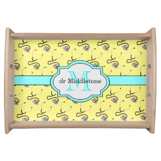 Funny stethoscopes for doctors on yellow name serving tray