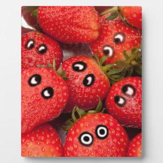 Funny strawberries. plaque