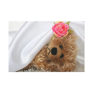FUZZY BEAR UNDER A WHITE SATIN BLANKET GALLERY WRAP CANVAS