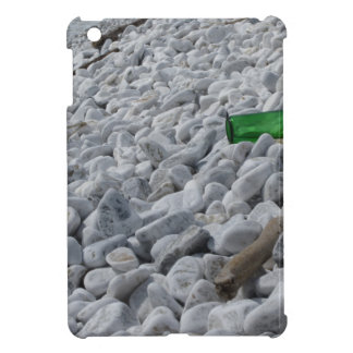 Garbage on the beach .Particular of a green bottle iPad Mini Cover