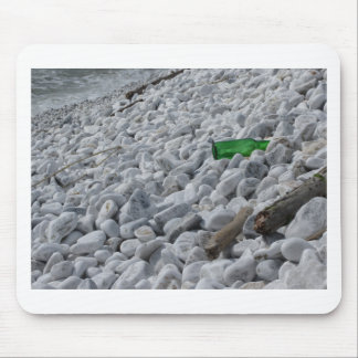 Garbage on the beach .Particular of a green bottle Mouse Pad