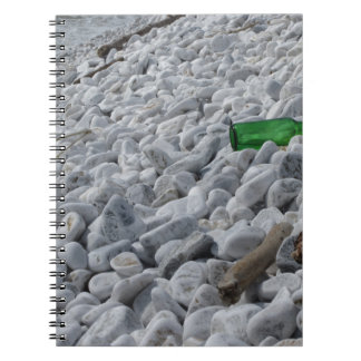 Garbage on the beach .Particular of a green bottle Spiral Note Book