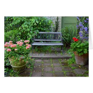 Garden bench on summer patio card