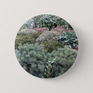 Garden centre with selection of nursery plants 6 cm round badge