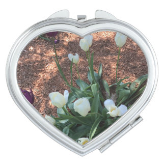 Garden of snow white tulip flowers compact mirror