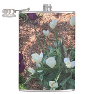 Garden of snow white tulip flowers hip flask