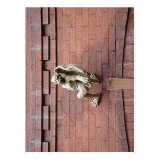 Gargoyle Hanging on  Red Brick Wall Postcard