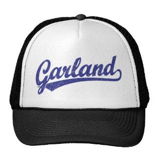Garland script logo in blue distressed cap