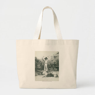 Garlene Tindall standing on a trick horse. Large Tote Bag