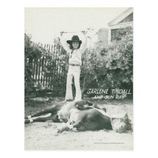 Garlene Tindall standing on a trick horse. Postcard