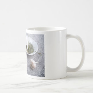 Garlic and spices on a gray fabric background coffee mug