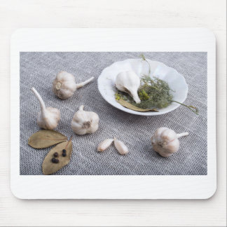 Garlic and spices on a gray fabric background mouse pad