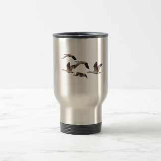 Geese in flight travel mug