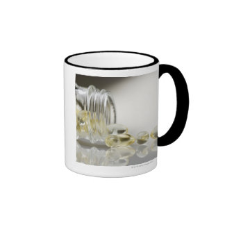 Gelcaps spilling out of glass bottle coffee mugs