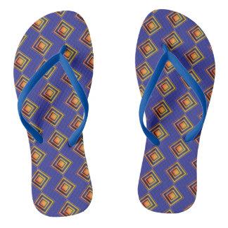 Geometric Blue Pattern and Golden Flip Flops