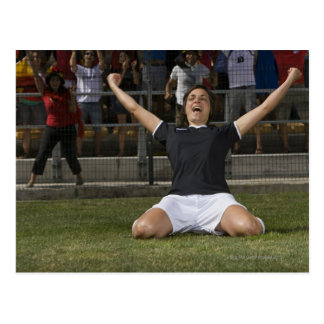 German female soccer player celebrating goal postcard