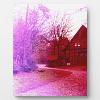 german wooden town house in forest red tint plaque