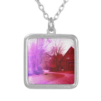 german wooden town house in forest red tint silver plated necklace