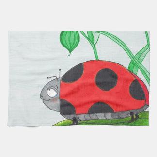 Giant red ladybug on a leaf tea towel