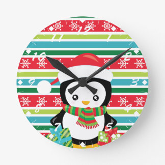 Gift Penguin on striped snowflake background Round Clock