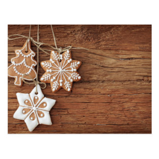 Gingerbread Cookies Hanging Over Wooden Postcard